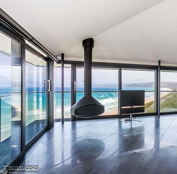 Diseño estratégico en casa moderna sostenida por un pilar (5)
